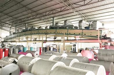 欣浪公司工厂涂胶复合生产机器